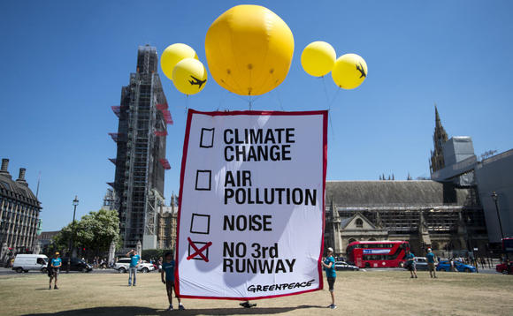 Greenpeace protested against the runway plans outside Parliament this afternoon | Credit: David Mirzoeff / Greenpeace