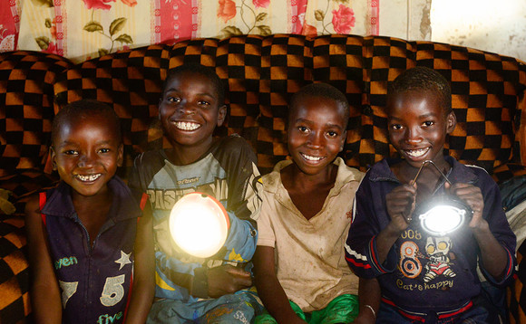 Children in Zambia with their SunnyMoney solar lights | Credit: Patrick Bentley
