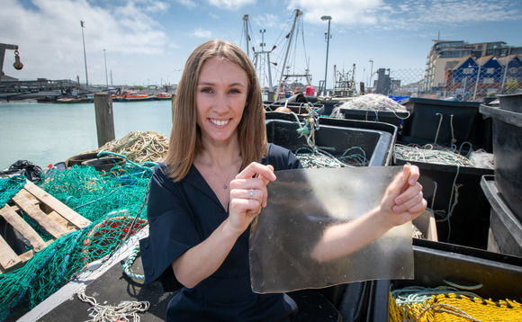 Lucy Hughes with her MarinaTex bioplastic film invention | Credit: University of Sussex