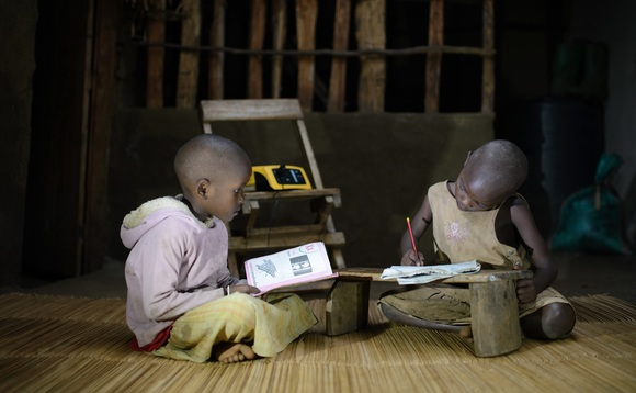 Children studying at night under light from Fenix's ReadyPay Power System | Credit: Fenix