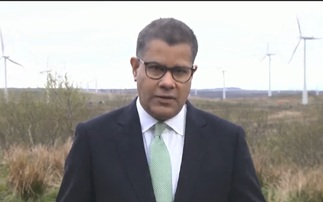 Alok Sharma speaking outside the Whitelee onshore wind farm near Glasgow