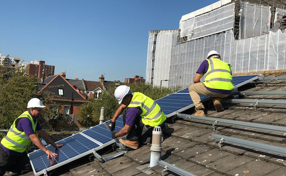 Solar panels being installed on the rooftops of social housing | Credit: Solarplicity