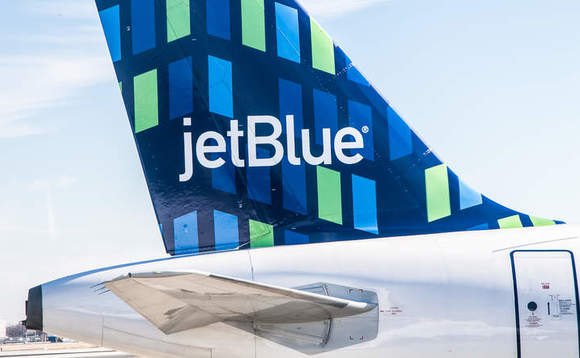 The tail of a JetBlue plane at New York's JFK airport / Credit: Shutterstock
