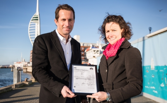 Susie Tomson with Ben Ainslie receiving BAR's  ISO 20121 | Credit: Landrover BAR