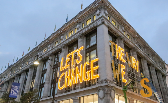 'Let's Change The Way We Shop' sign is hoisted at Selfridges' flagship store on Oxford Street | Credit: Selfridges