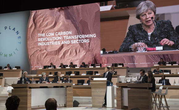 UK PM Theresa May at the One Planet Summit in Paris  Credit: Number 10