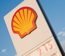 Shell trims carbon footprint, as boss vows to 'step up' climate efforts