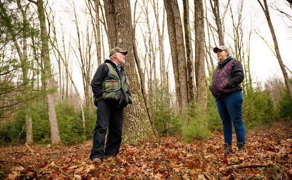 Susan Benedict, right, whose family owns 2,087 acres of forest near State College, Pennsylvania, consults with her forestry manager / Credit: American Forest Foundation